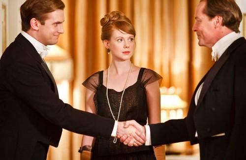 Matthew greets Sir Richard Carlisle, while Lavinia looks on