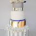Silver white & purple wedding cake.