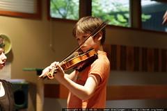 nick playing violin for amy