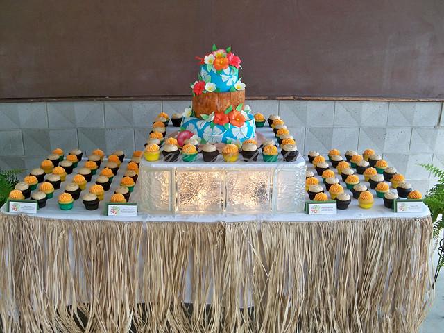 Hawaiian Themed Wedding Cake and Cupcake Display