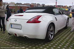 nissan 350z(0.0), automobile(1.0), automotive exterior(1.0), sport utility vehicle(1.0), wheel(1.0), vehicle(1.0), automotive design(1.0), nissan 370z(1.0), nissan(1.0), bumper(1.0), land vehicle(1.0), luxury vehicle(1.0), supercar(1.0), sports car(1.0),