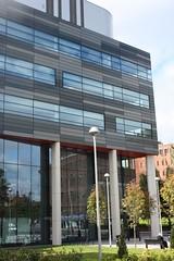 window covering(0.0), plaza(0.0), tower block(1.0), building(1.0), commercial building(1.0), architecture(1.0), headquarters(1.0), brutalist architecture(1.0), condominium(1.0), facade(1.0), downtown(1.0), campus(1.0),