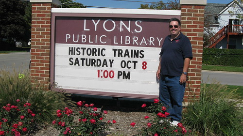 Eddie K standing by the sign at the Lyons Public Library.  Lyons Illinois USA. Saturday, October 8th, 2011. by Eddie from Chicago