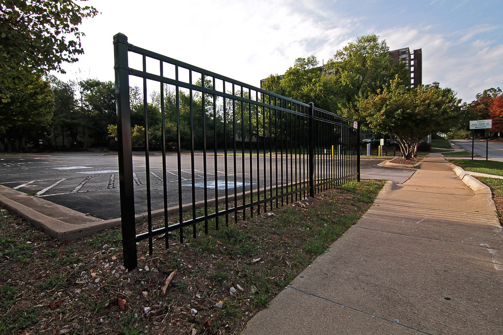 Curb jumping leads to fence installation near paid parking