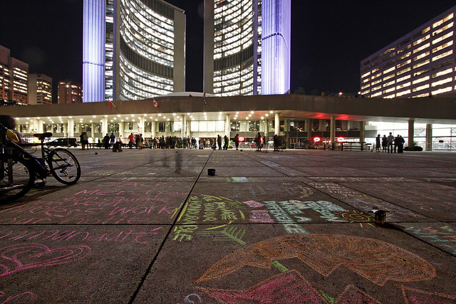 People Pay Tribute to Jack Layton in front of City Hall Late at Night