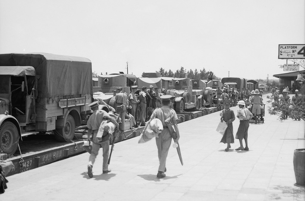 British Army Eleventh Hussars arriving at Ludd. Train load of armoured cars etc. arriving at the Lydda Junction from Egypt with the 11th Huzars on July 15, 1938