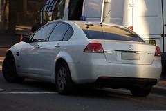 sports car(0.0), automobile(1.0), automotive exterior(1.0), executive car(1.0), wheel(1.0), vehicle(1.0), automotive design(1.0), mid-size car(1.0), compact car(1.0), bumper(1.0), pontiac g8(1.0), sedan(1.0), land vehicle(1.0), luxury vehicle(1.0),