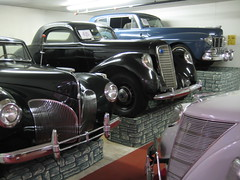 packard super eight(0.0), mid-size car(0.0), touring car(0.0), cadillac v-16(0.0), automobile(1.0), vehicle(1.0), custom car(1.0), automotive design(1.0), hot rod(1.0), antique car(1.0), sedan(1.0), vintage car(1.0), land vehicle(1.0), luxury vehicle(1.0), motor vehicle(1.0), classic(1.0),