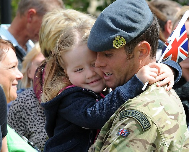 A Soldier from the RAF Regiment is Hugged by his Daughter on his Return from Afghanistan