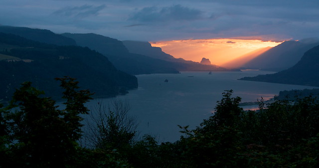 Sunrise spotlights Beacon Rock in the Columbia Gorge