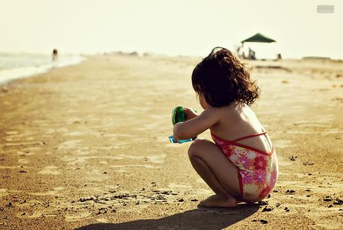 ocean sunset galveston beach water girl 50mm kid sand nikon texas shore magichour goldenhour beachtoys playinginthesand d80