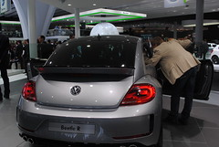 family car(0.0), volkswagen cc(0.0), sedan(0.0), automobile(1.0), volkswagen beetle(1.0), automotive exterior(1.0), exhibition(1.0), wheel(1.0), volkswagen(1.0), vehicle(1.0), automotive design(1.0), auto show(1.0), city car(1.0), compact car(1.0), bumper(1.0), land vehicle(1.0), luxury vehicle(1.0),
