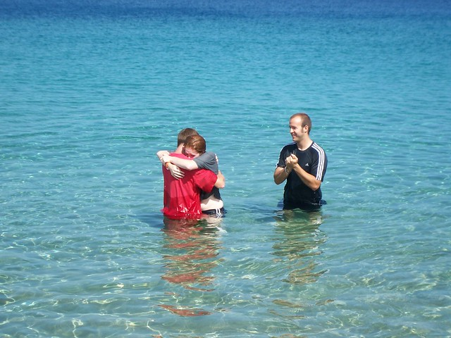 first post-baptism hug from dad
