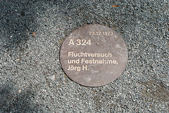 Photo of Jörg H. brown plaque