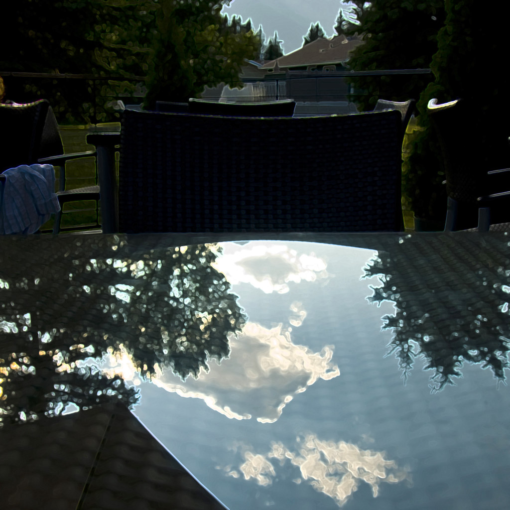 Cloud Reflection in Outdoor Table