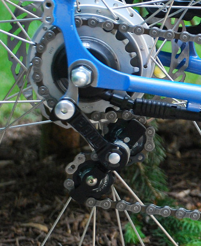 <p>Gunnar owner Steve's Fastlane is outfitted with a SRAM i-Motion.  To keep things simple, he installed a Paul's chain tensioner on the derailleur tab.  Easy and adaptable.  61597</p>