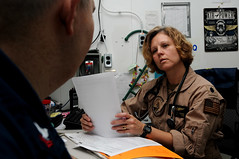 USS George H.W. Bush medical officer reviews medical information with by Official U.S. Navy Imagery