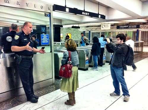 #opbart @JoshWolf photographing a woman complaining to #DanHartwig @sfbart