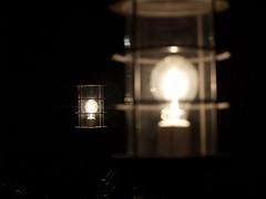 candle(0.0), reflection(0.0), lantern(0.0), incandescent light bulb(1.0), light fixture(1.0), yellow(1.0), white(1.0), light(1.0), darkness(1.0), night(1.0), lighting(1.0), black(1.0),