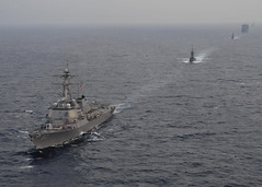 In this file photo, guided-missile destroyer USS Chung-Hoon (DDG 93) leads a formation of U.S. and Republic of Singapore Navy ships in the South China Sea Aug. 26 during exercise Cooperation Afloat Readiness and Training (CARAT). (U.S. Navy photo by Mass Communication Specialist 2nd Class Katerine Noll)