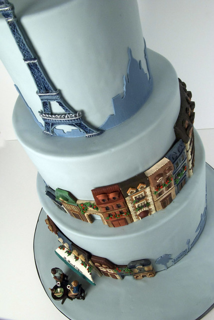 A Parisian Theme wedding cake with the Eiffel Tower and quaint Paris street
