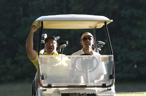 Obama driving a golf cart