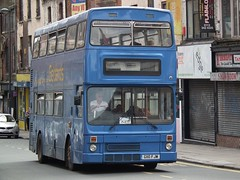 trolleybus(0.0), dennis dart(0.0), flxible new look bus(0.0), metropolitan area(1.0), vehicle(1.0), transport(1.0), mode of transport(1.0), public transport(1.0), double-decker bus(1.0), tour bus service(1.0), land vehicle(1.0), bus(1.0),