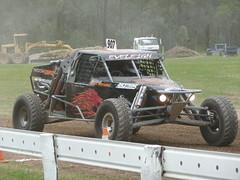 auto racing(0.0), compact sport utility vehicle(0.0), jeep wrangler(0.0), automobile(1.0), racing(1.0), vehicle(1.0), dirt track racing(1.0), off road racing(1.0), off-roading(1.0), rally raid(1.0), off-road vehicle(1.0), bumper(1.0), land vehicle(1.0),