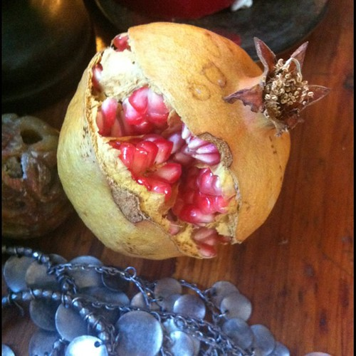 Split pomegranate, silver. It fell too soon from our tree.