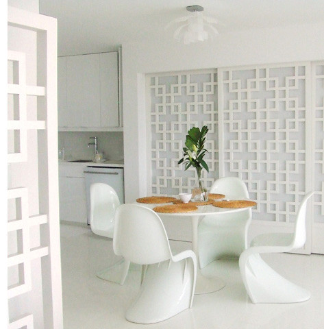 White-on-white dining area: Saarinen table + Panton chairs