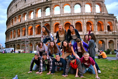 Our class in front of the colosseum,(attempting) to make a pyramid