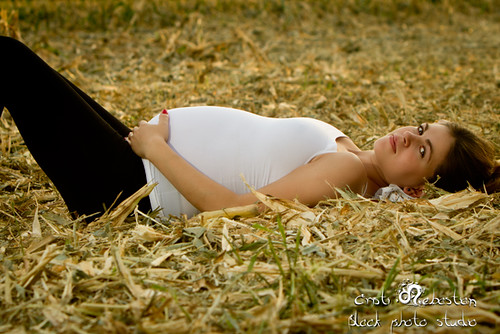 Pregnant Woman Prostrate, Lying on the Ground
