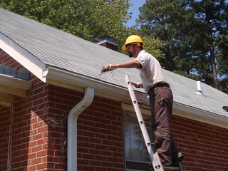 Cyrus Brame cleaning gutters