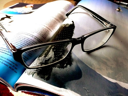 I'm done reading my magazine, I quit. magazine & eyeglasses