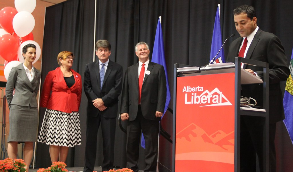 Raj Sherman delivers his leadership victory speech as leadership chair Josipa Petrunic, and candidates Laurie Blakeman, Hugh MacDonald, and Bruce Payne look on (September 2011).
