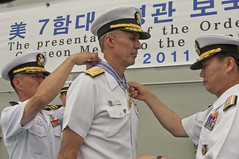 BUSAN, Republic of Korea (Aug. 25, 2011) Republic of Korea navy's Chief of Naval Operations Adm. Kim Sung-chan, right, presents the Republic of Korea Order of National Security Merit Gugseon Medal to Commander, U.S. 7th Fleet Vice Adm. Scott Van Buskirk, center, at an award's ceremony on board the Republic of Korea navy amphibious ship ROKS Dokdo (LPH 6111). (U.S. Navy photo by Mass Communication Specialist 2nd Class Kenneth R. Hendrix)