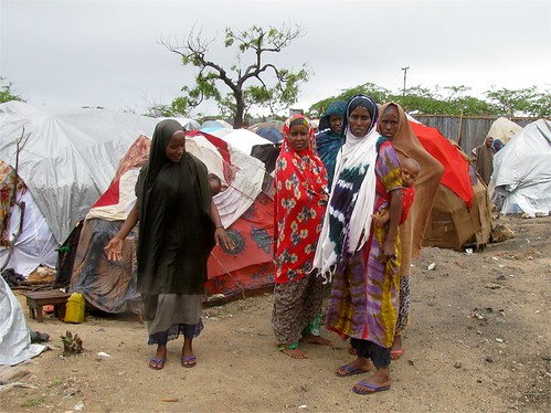 Women in the Waberi District of Mogadishu, Somalia where they have re-located to receive drought relief from international humanitarian organizations. Despite the reports of famine fewer people are arriving in the capital. by Pan-African News Wire File Photos