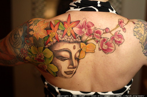 detail of rachel's new buddha tattoo