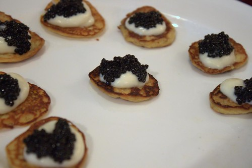 Caviar & white chocolate on a curry blini