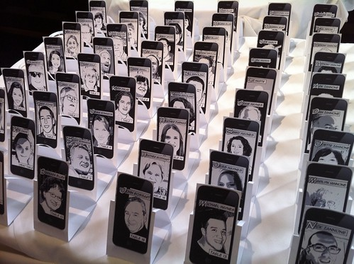 Comic-style iPhone-framed tablecards designed by Bride & Groom