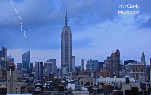 Zzzzzt!  Bank of America Tower gets zapped by lightning with the Empire State Building looking on