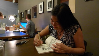 The 2010 3-Day Novel Contest winner signs her book at the launch