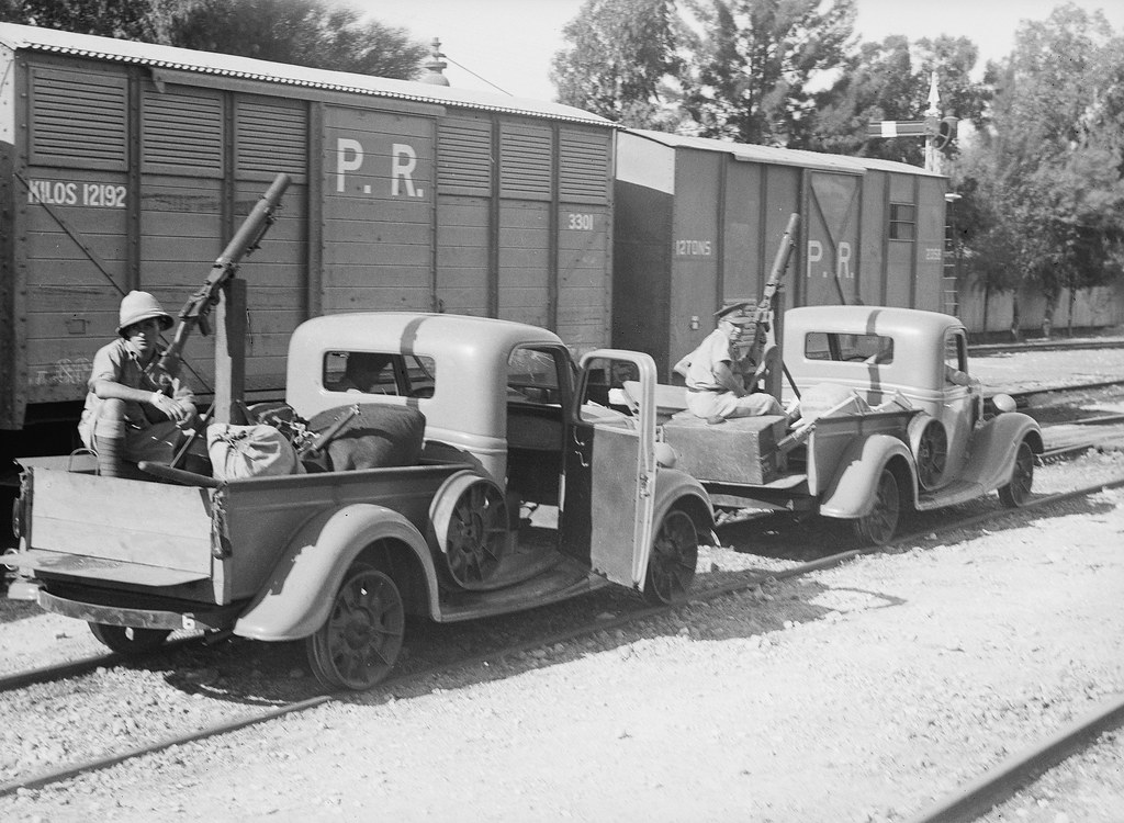 British Army railroad vehicles/trollies with machine-guns landed from the S.S. Dorsetshire in Palestine - circa 1936