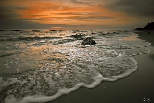 sunset sea stones baltic lithuania karkle