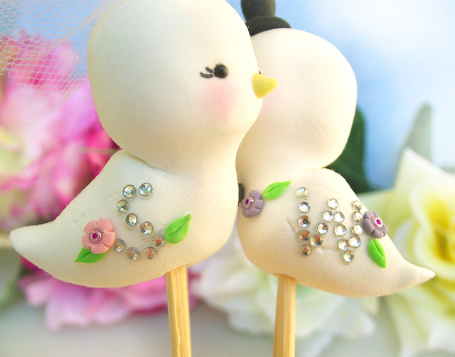 Sparkling initials love birds wedding cake toppers detail