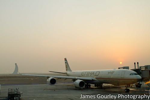 sun hot plane sunrise design airport desert jet abudhabi airline heat airbus land passenger boeing rise unitedarabemirates mancity etihad