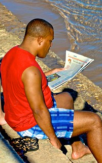 Image de Praia das Moitas. sea man beach portugal reading newspaper reader cascais