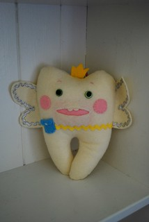 My version of a tooth-fairy pillow, from mmmcrafts http://mmmcrafts.blogspot.com/2009/02/tooth-pillow-revisited.html