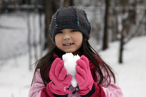 my daughter with snow