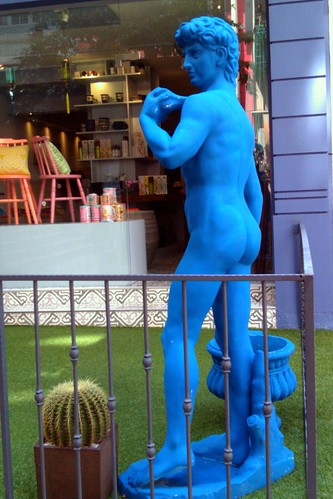 Papa Smurf backs away from the cactus (before he backs INTO the cactus)